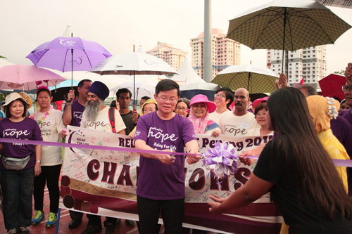 The Penang Chief Minister cuts the ribbon to kick off the walkabout.