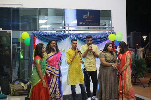 Entertaining the audience with a medley of popular Tamil songs.