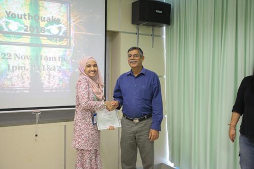 Dr Nagarajan congratulates Nur Batrisyia on her win.
