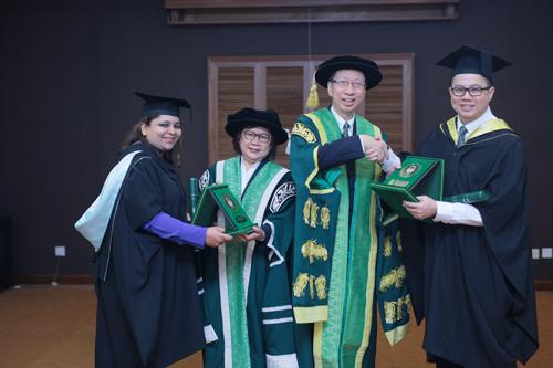Prof Zoraini and Dr Koh congratulate top students Poonam Devi (left) and Paul Goh (right).