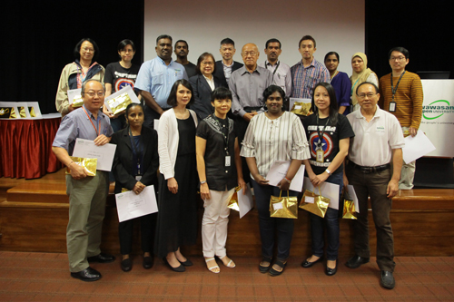 Dr Chin (back row, centre, with glasses) with the 10-year service award recipients.