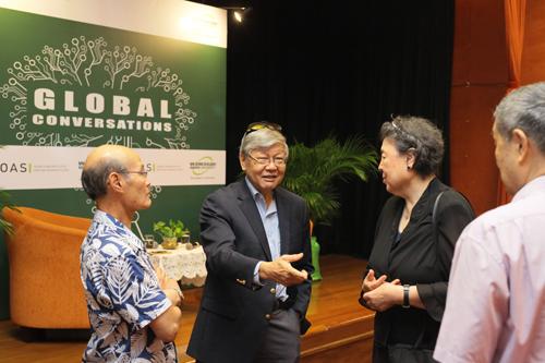 Tan Sri Andrew Sheng converses with Dr Shiu (left) and Ms Wang.
