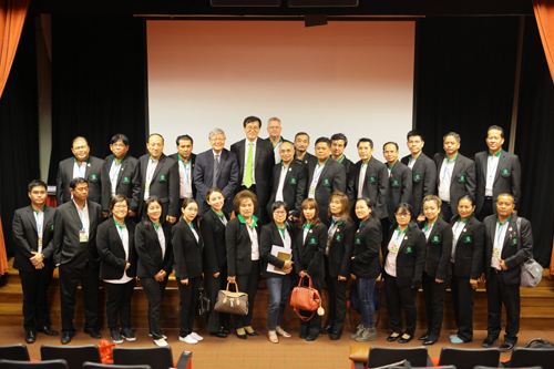 Dr Sak Prasandee (2nd row centre, with glasses) standing beside Dr Changyong Rhee, the speaker of the public talk from the International Monetary Fund (IMF).