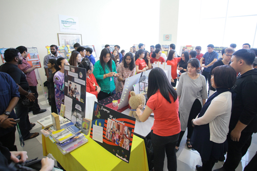 Staff and students admiring the exhibits.