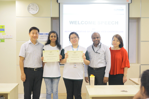 WOU Bursary Award recipients Nur Syaza and Clarissa (2nd and 3rd from right).