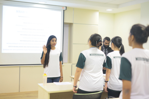 Karishma leads in reciting the students'pledge.