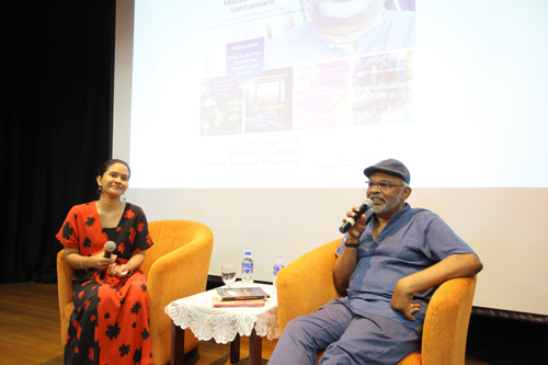 Arathai of WOU (left) in a lively conversation with the celebrated poet and author.