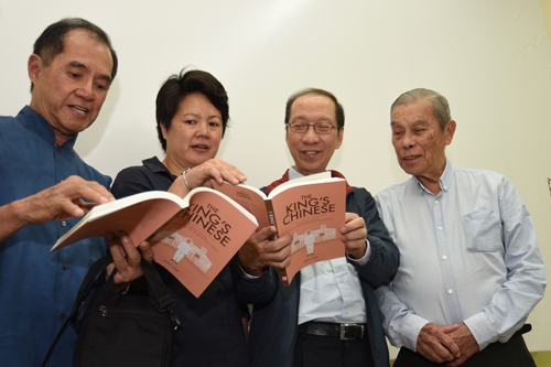 (From left) Dato' Seri Stephen, Daryl Yeap, Tan Sri Koh and Dato' Seri Goh browsing through the book.