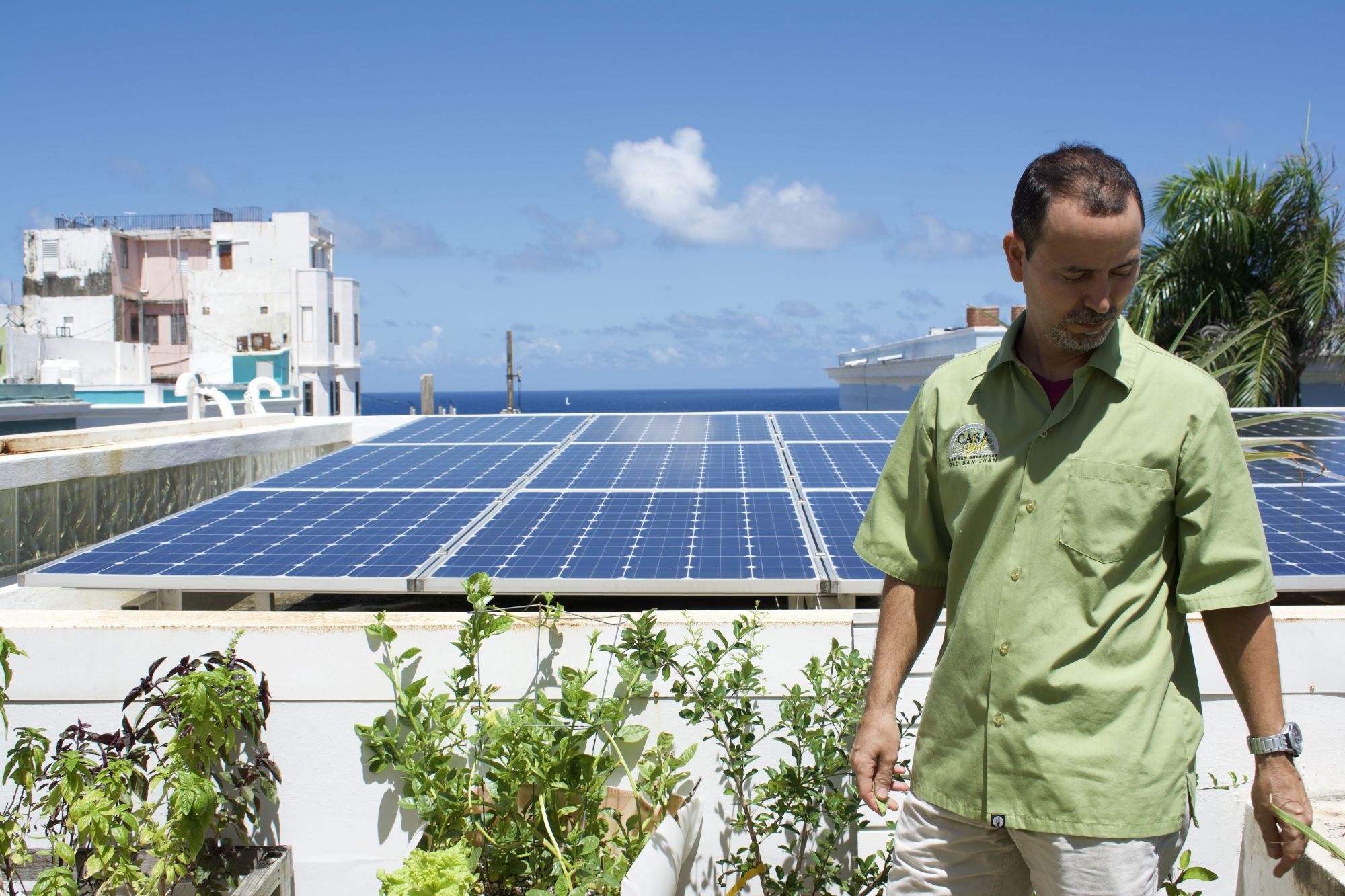 © Marie Fazio: Ramirez with his solar panels on the roof of Casa Sol.