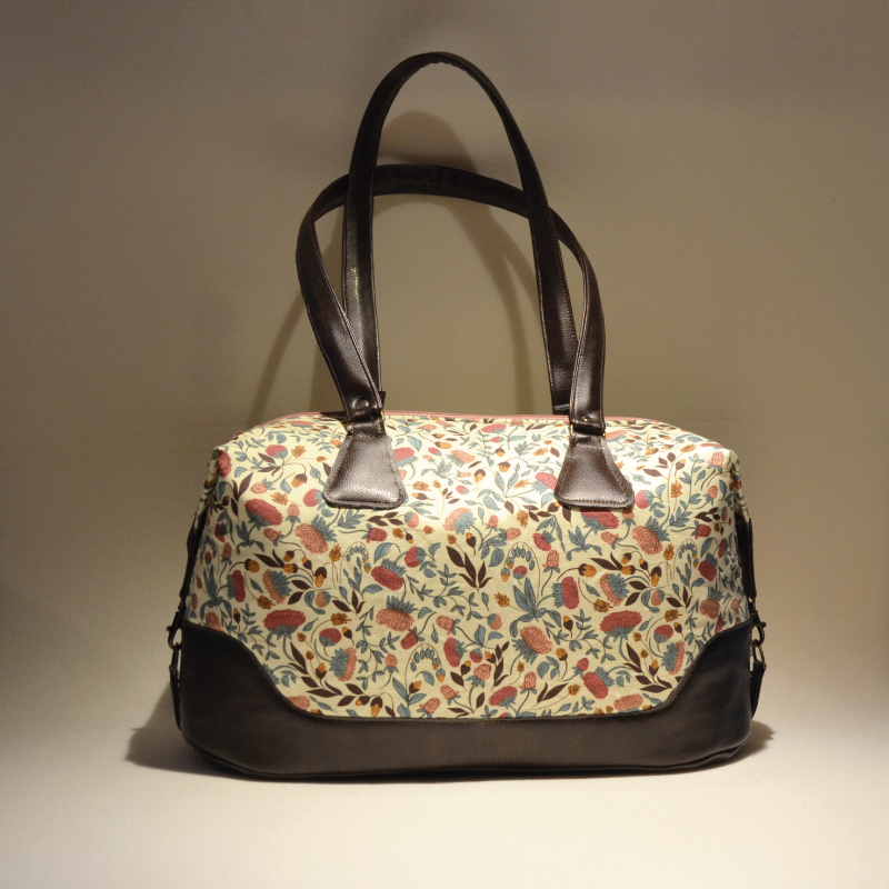 "This pattern is called ""Morning Bloom"" and is included in a pattern collection I'm still working on called GARDEN GROOVE. This is the ""Morning"" color set. Contrasting brown faux leather is a perfect match and makes the bag really stylish and gives it a downtown look."