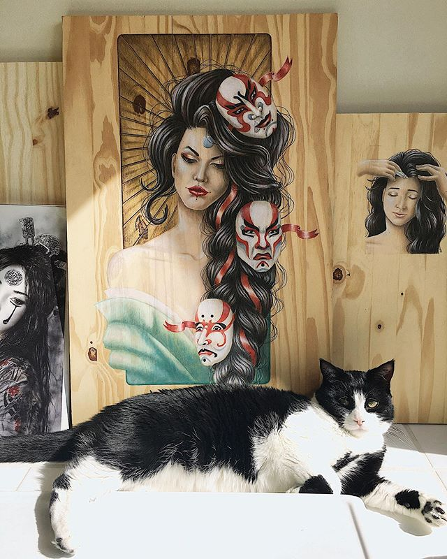 "✨Precious studio moments✨  My furbaby Luffy posing with ""Tangled Thoughts: Kabuki"". Illustration created with color pencil and PanPastel on wood canvas👺✍️🎨 #tbt #kabuki #japanese #illustration #danidesignart . . . . . . . . . . . #artwork_in_studio #studioart #fineart #geisha #woodart #panpastel #prismacolor #colorpencil #surrealart #wallart #worldofpencils #beautifulbizarre #phillyart #phillyartist #illustrator #designer #artistsoninstagram"