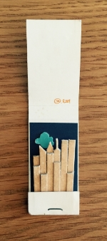 a matchbook from, Obeca Li, another restaurant around the corner from the Odeon, transformed into New York City's skyline at the time