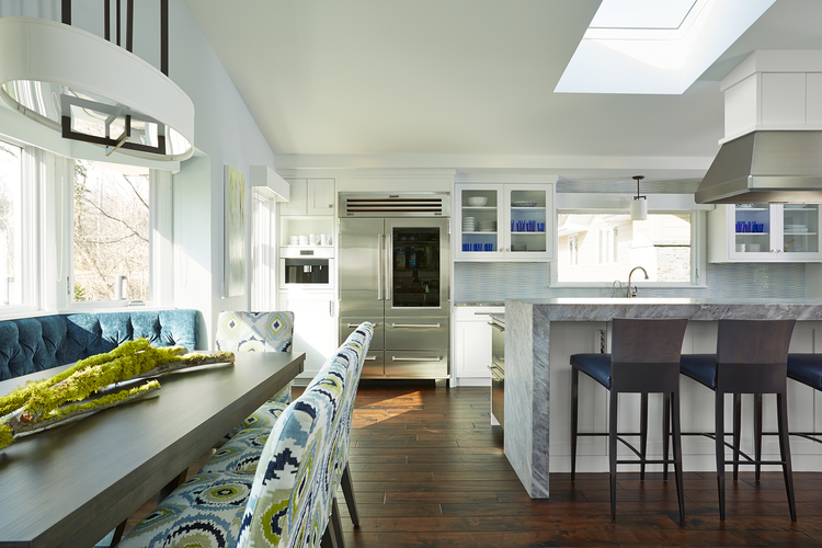 Edina Show-stopping Kitchen Creates Entertaining Space  With one step into this Edina kitchen, the intake of the natural light from the large windows and four skylights creates a brightness that cannot be compared.