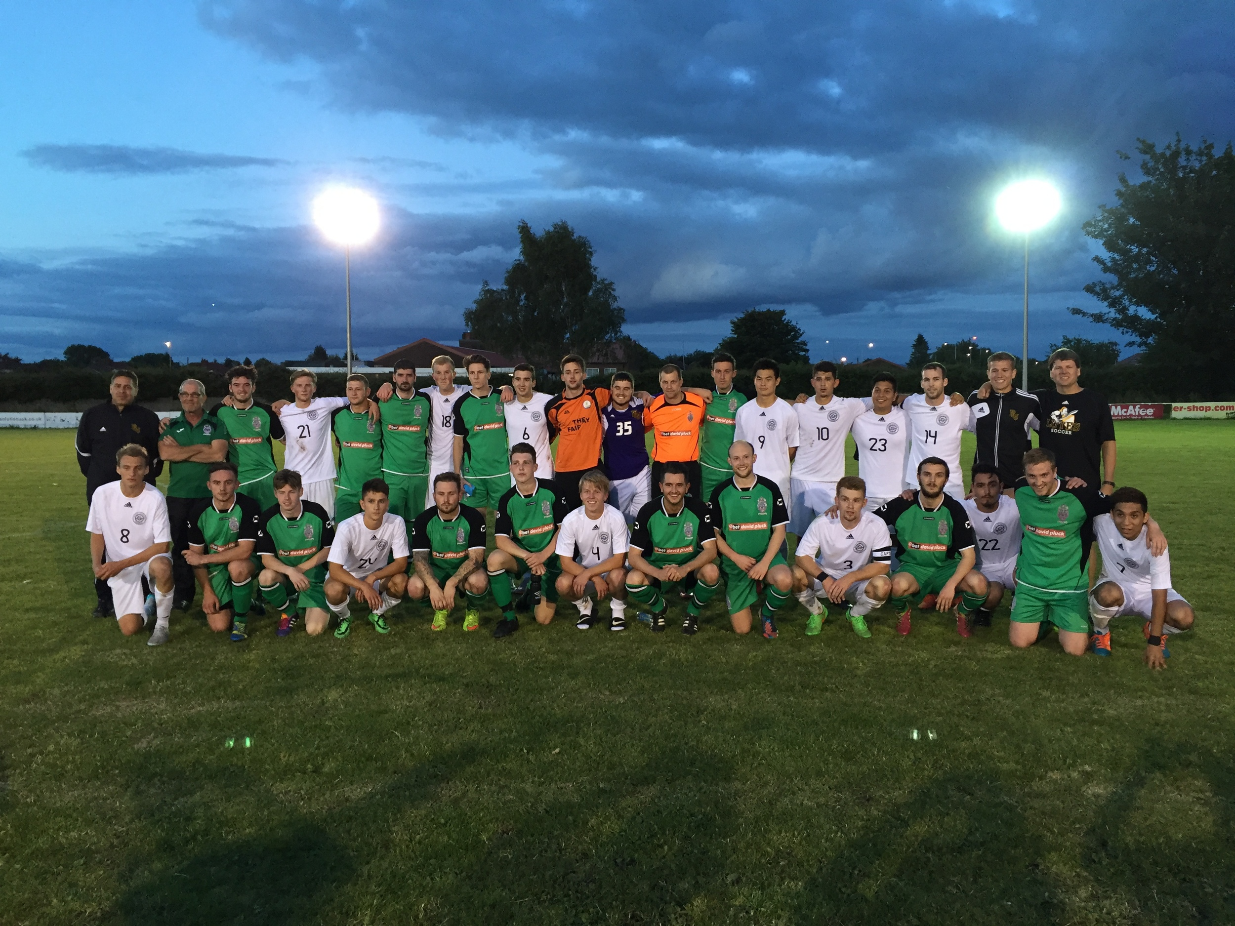 Both sides get together for a post-match photo