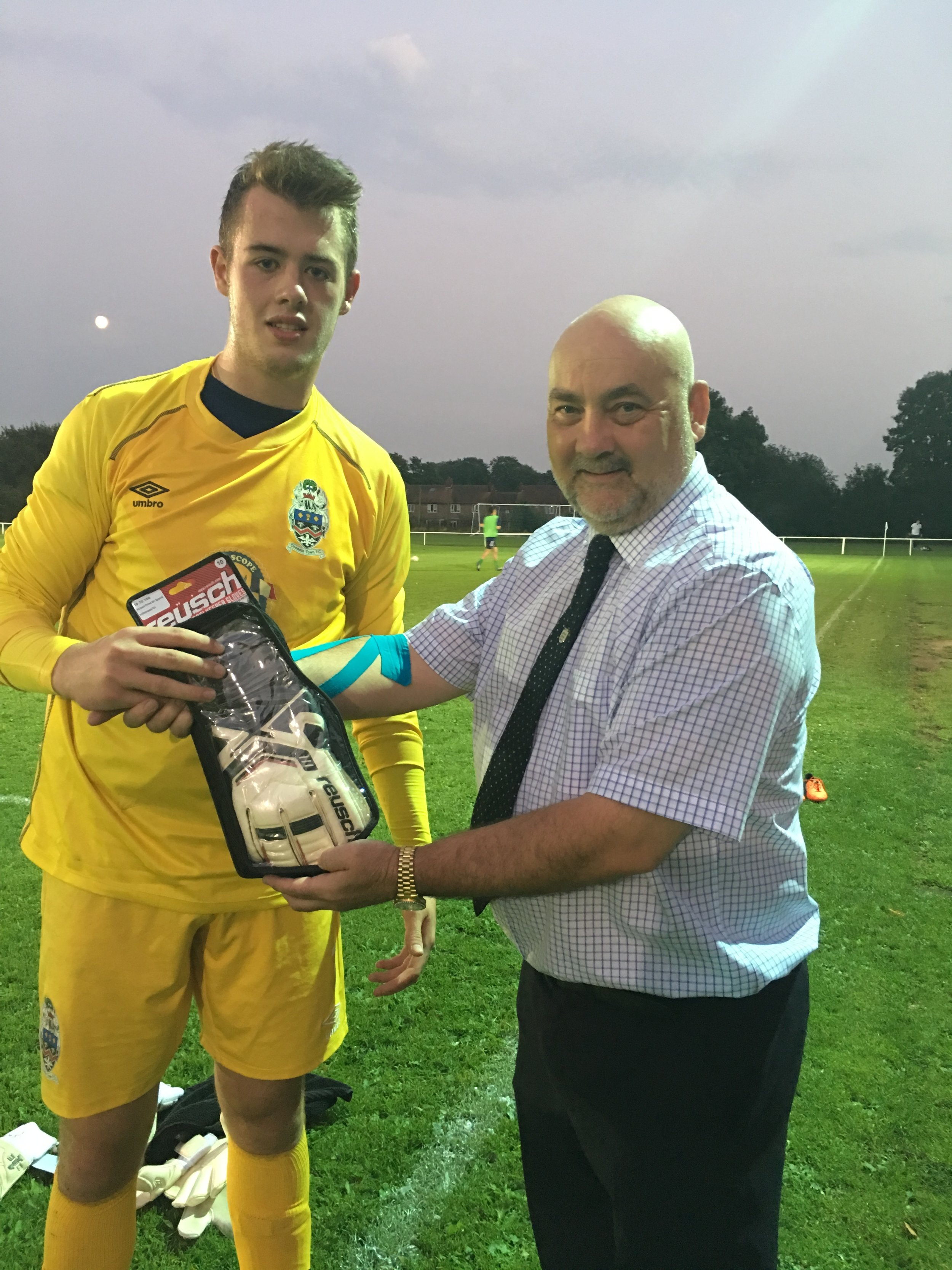 Ben Jupp receiving his Goalkeeper of the Month Award from the Hallmark Security League's Ian Williams before kick-off