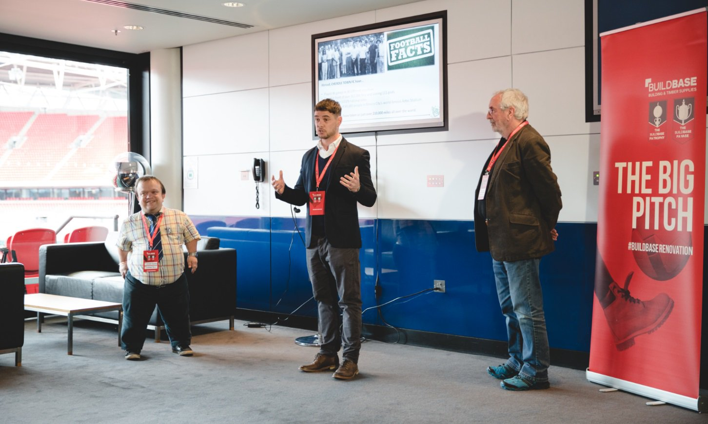 Craig Brennan (centre) with committee members Stuart Crawford and Brian Lindon during the presentation day at Wembley Stadium.