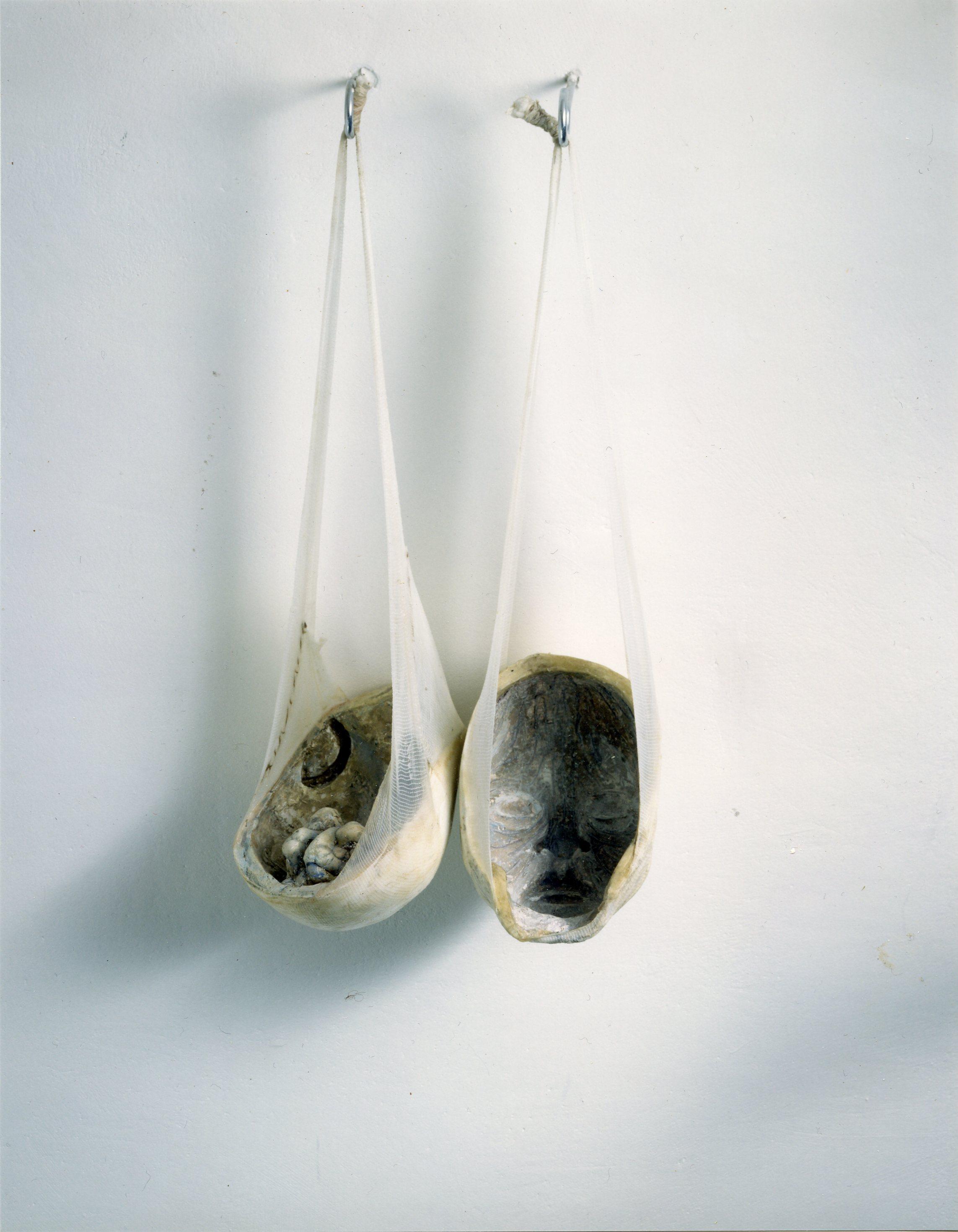 """Toril Rygh,""""Barnehoder"""", 1994 .Mixed media: bandage,gips, voks og farge"""
