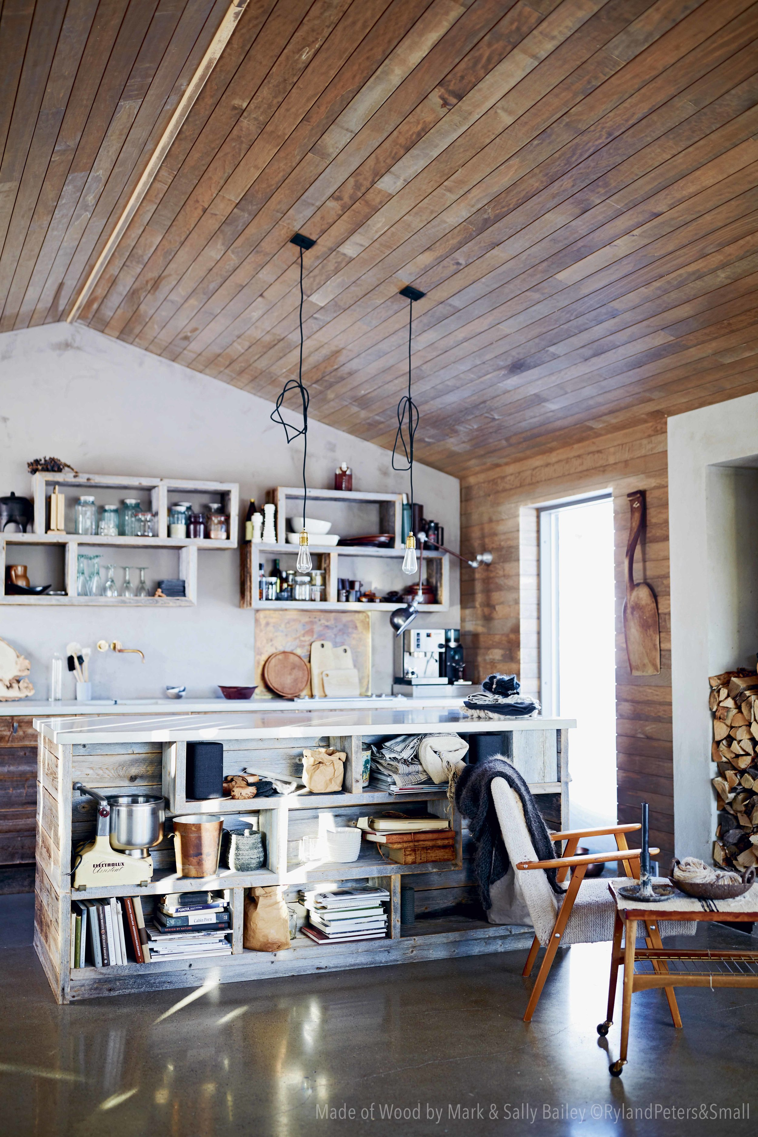"""The more than 100 years old barn wood in our cabin kitchen balanses the rough concrete. Photo from the book """"Made of Wood"""" by Mark og Sally Bailey, photo by Debi Treloar, copyright Ryland Peters & Small."""