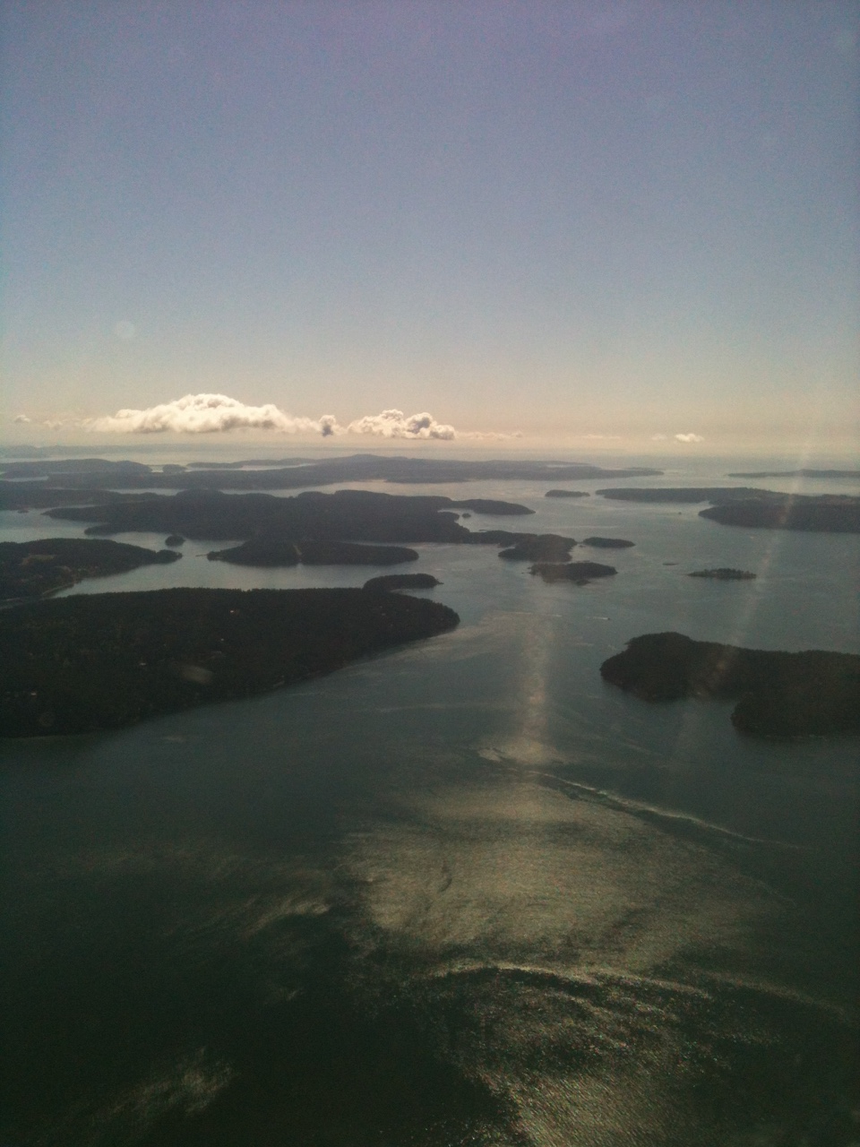 Flying southward above the San Juan Archipelago, Jones Island on the right, Orcas Island on the left.
