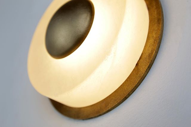 alabaster, brass, and warmth.