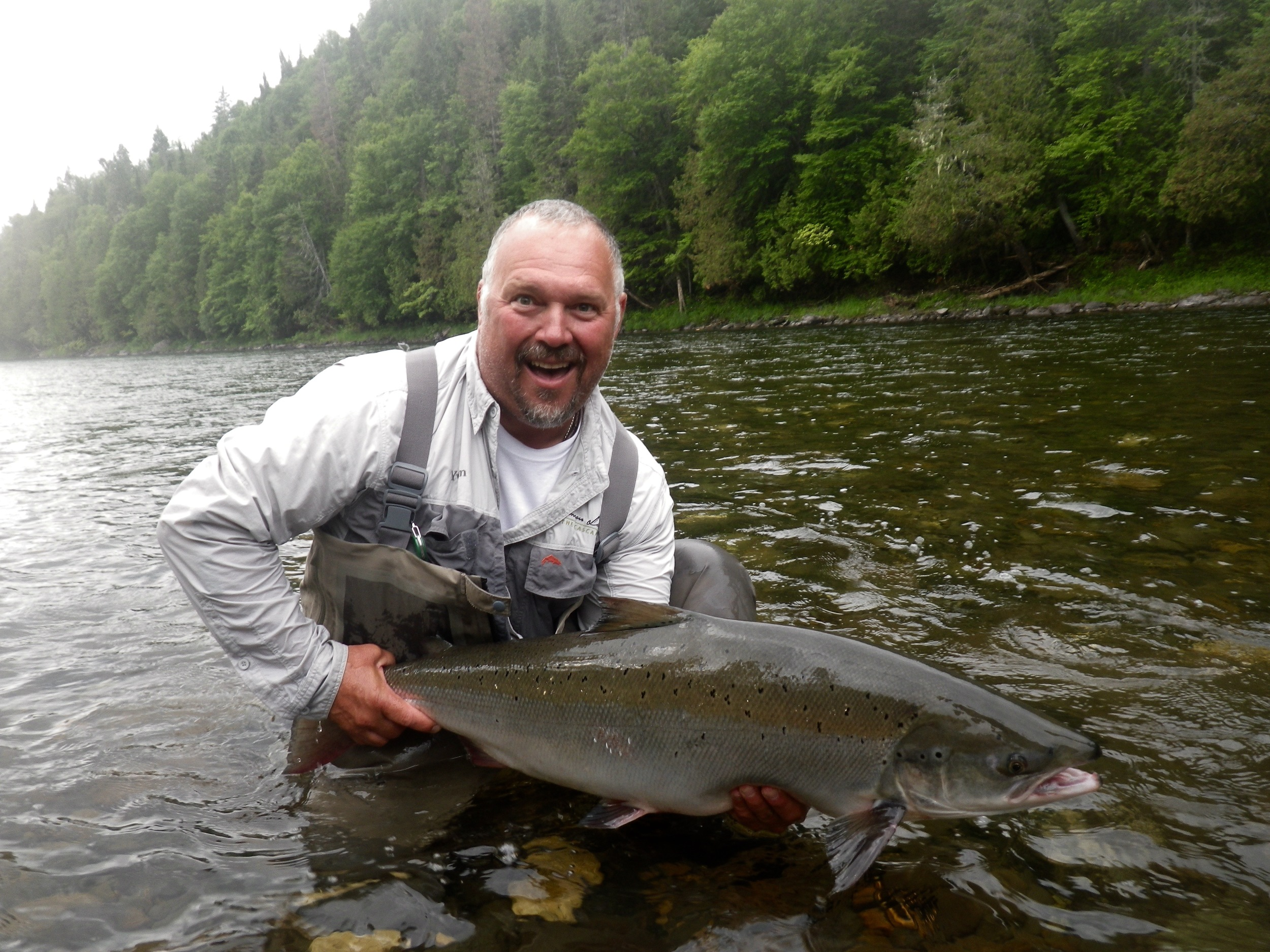 Salmon Lodge Guide Yvan Bernard puts a nice one back in the Grand Cascapedia. Yvan know where to find them and how to catch them!