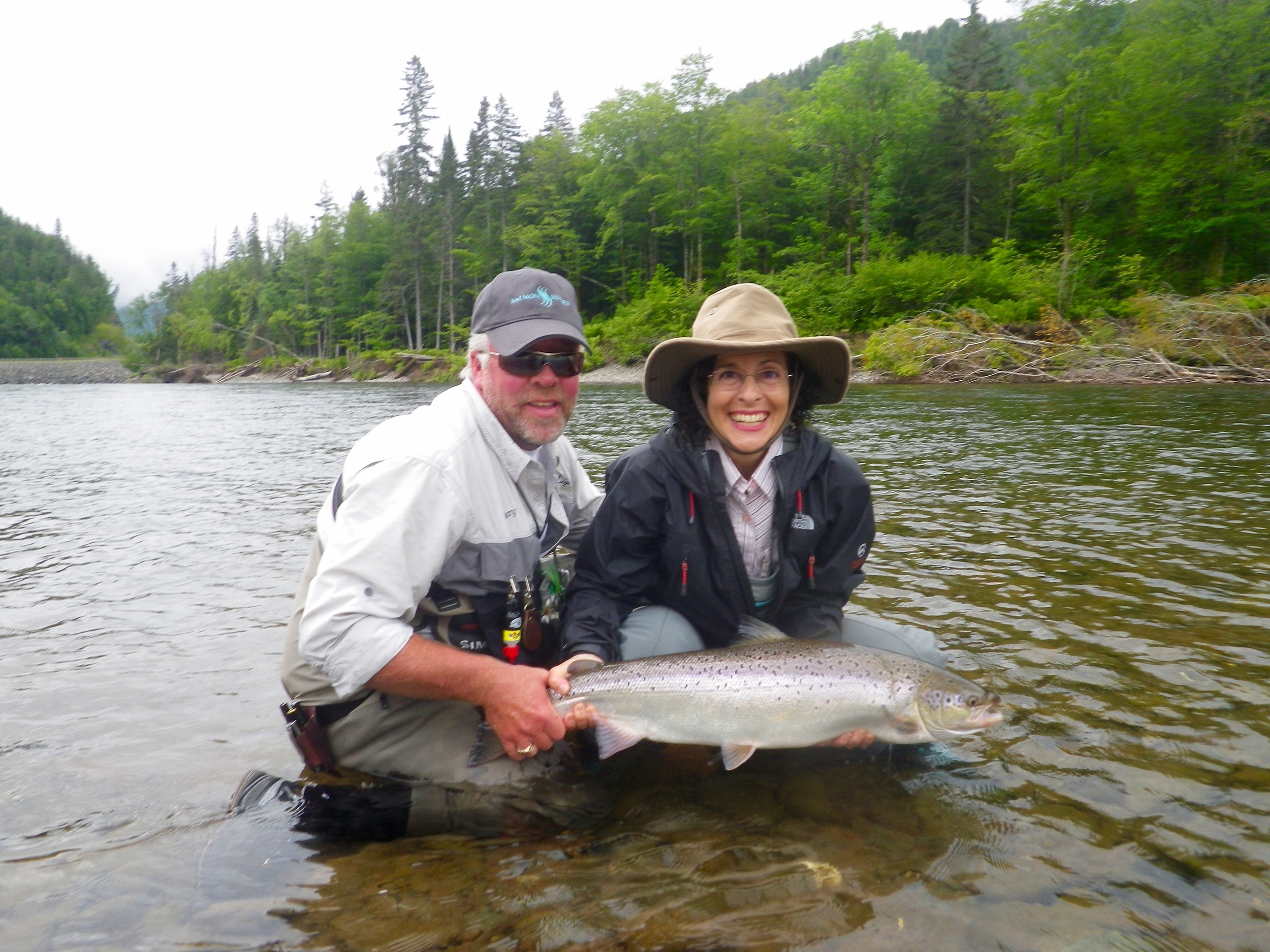 Mary Vandusen with Salmon Lodge guide Larry D on the Grand Cascapedia, Nice one Mary!