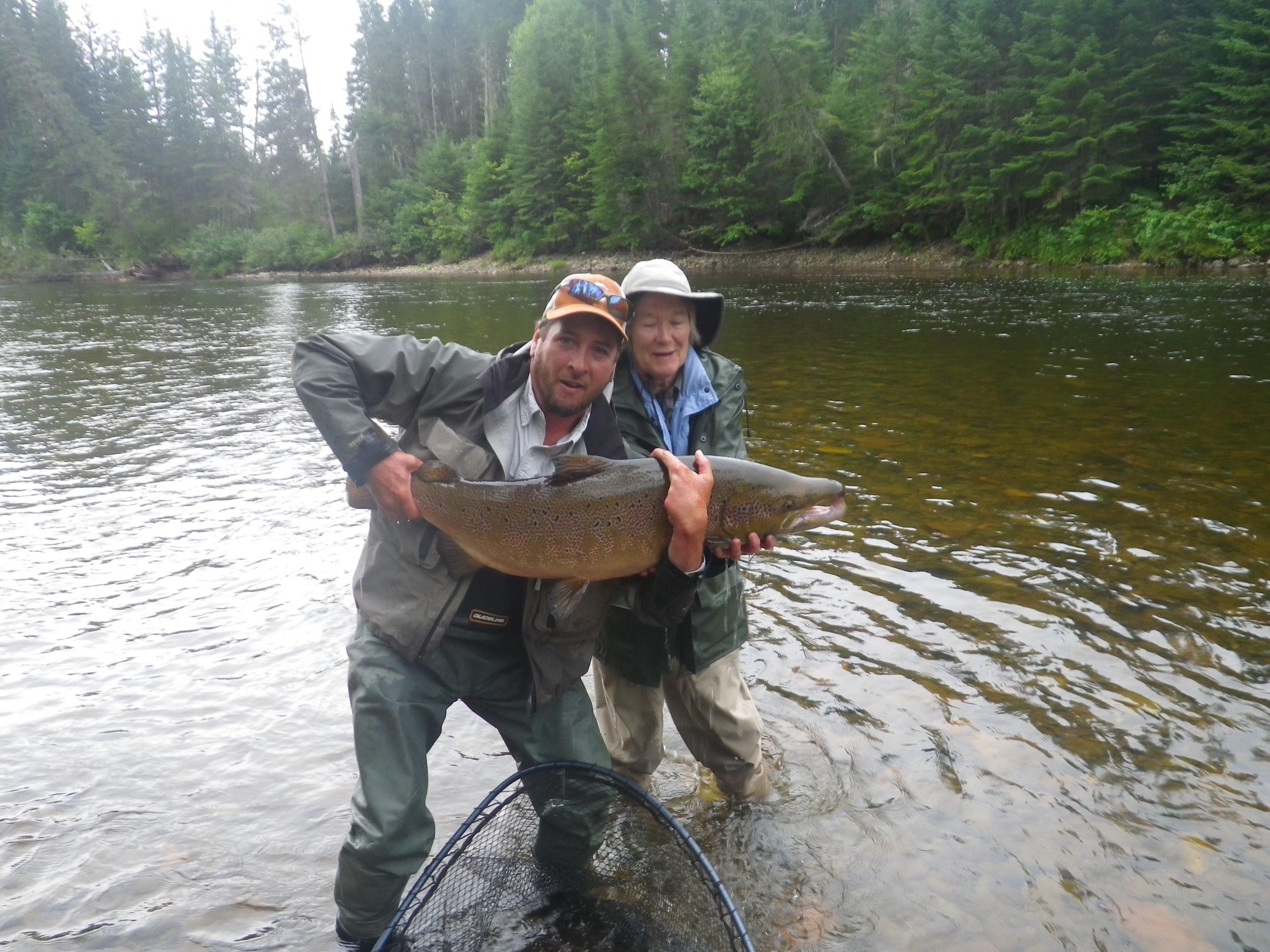 Annie Iliffe and Salmon Lodge guide pat Trudel with a fine specimen from the Grand Cascapedia. Congratulations Annie!