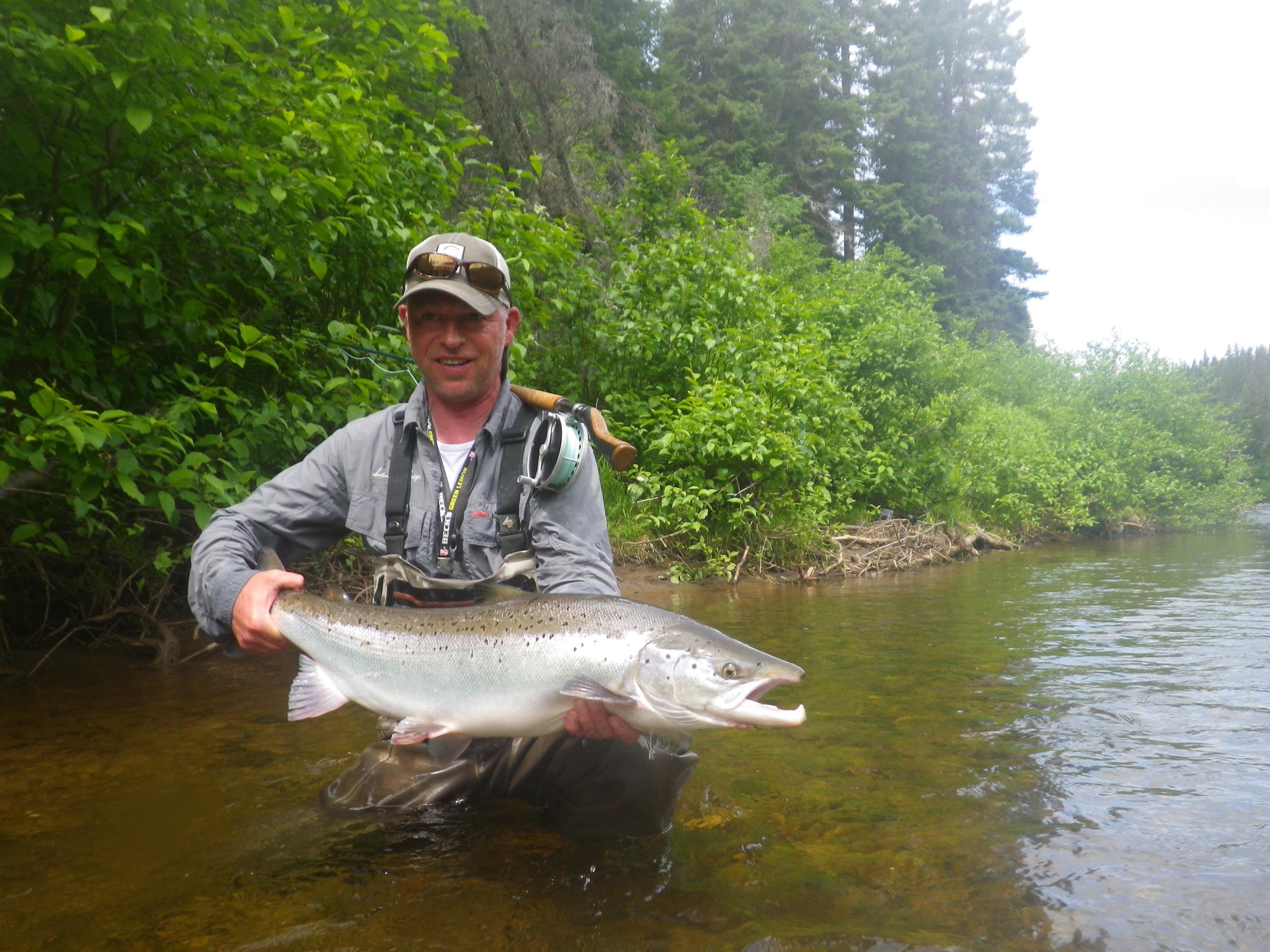 Salmon Lodge regular Thomas Mahanke with a fine Grand Cascapedia salmon, Nice fish Thomas!