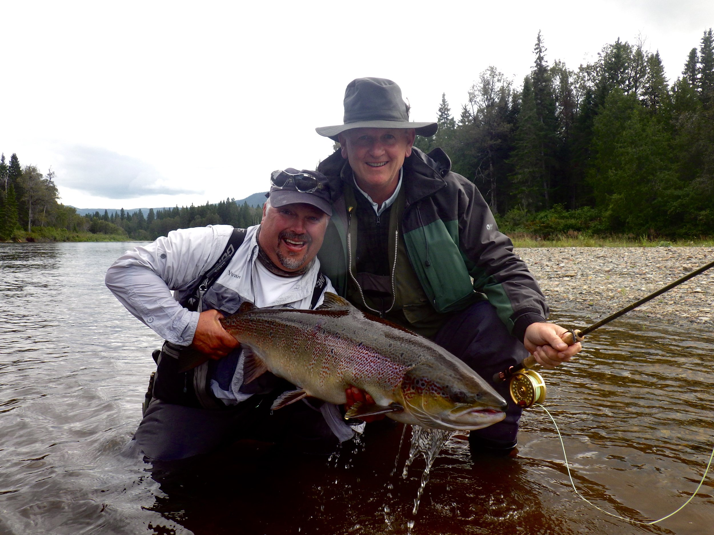 Salmon Lodge guide Yvan Bernard (left) and angler Stephen Coull with a big Grand Cascapedia Salmon. Congratulations Stephen!