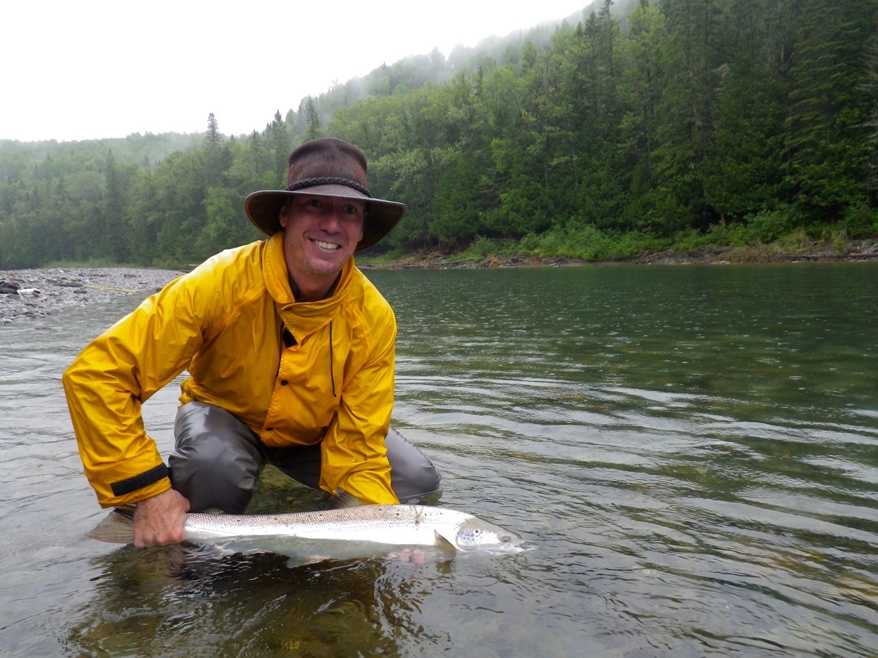 Louis Armand Bombardier releases a nice salmon back to swim again, Congratulations Louis Armand! Well done.