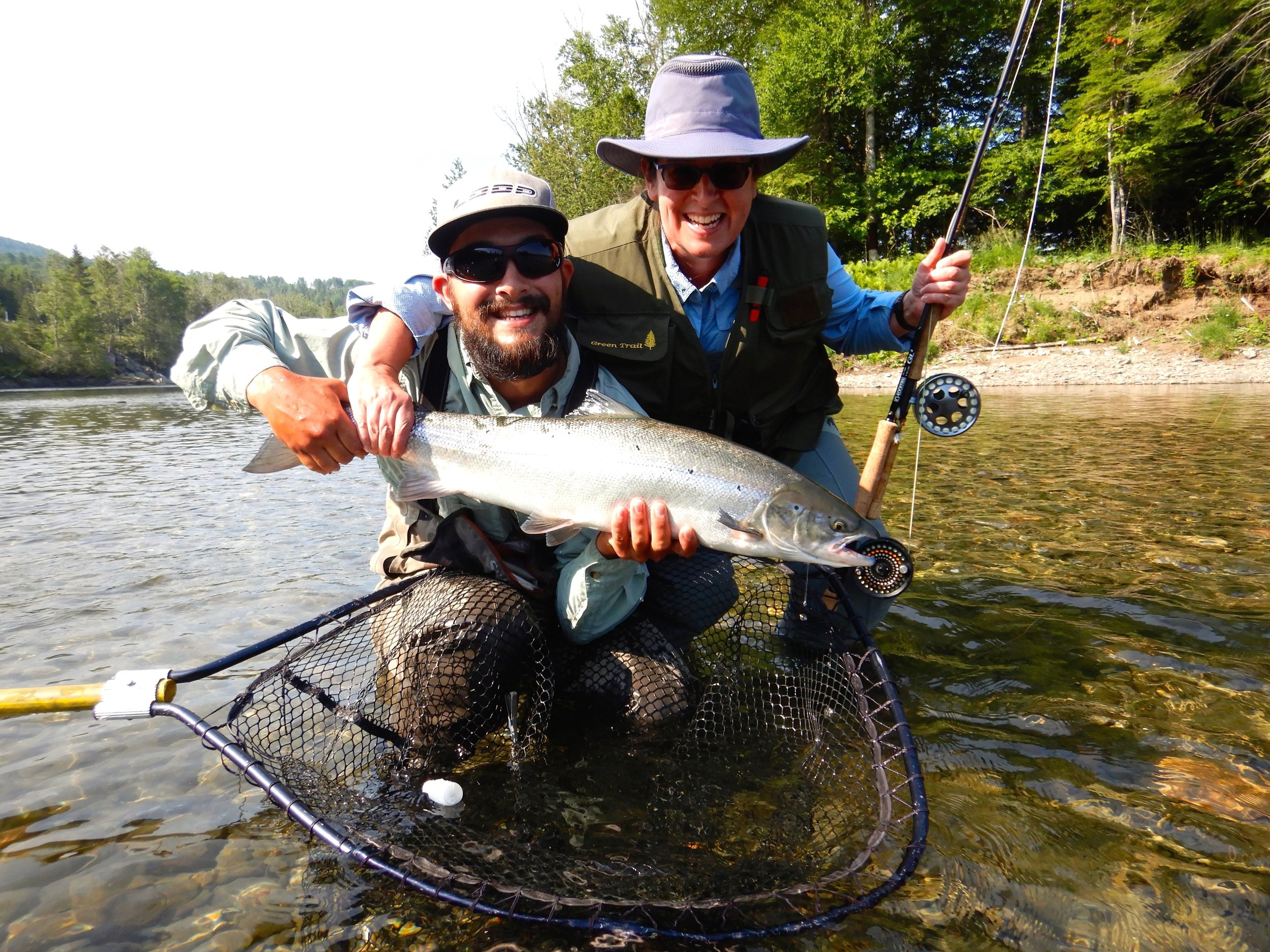 This was Marie France Langlois's first time salmon fishing, the first day she landed three!!! here she is with Salmon Lodge guide Clement Bernier. Way to go Marie France and Clement!