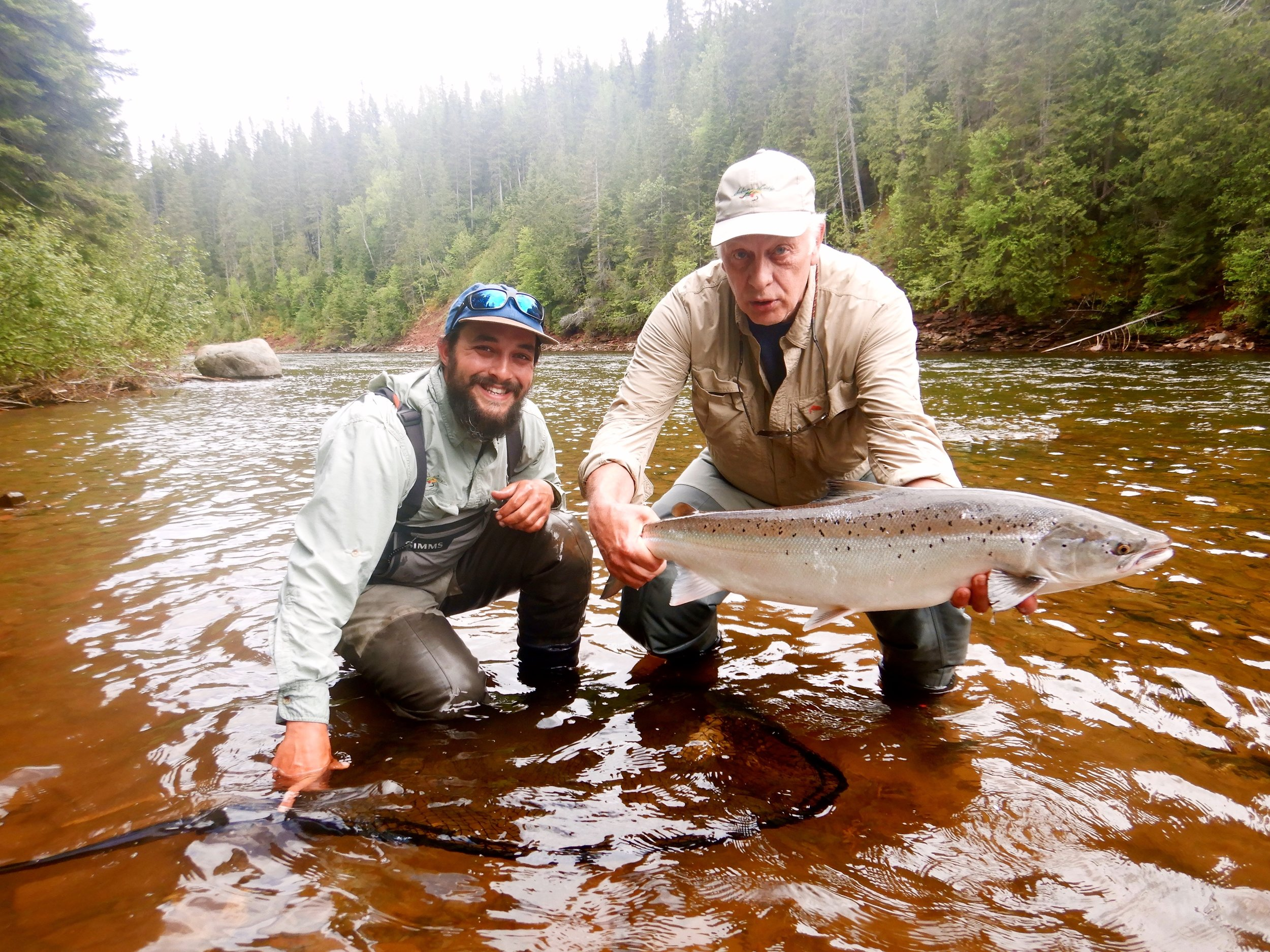Claude Dagenais (right) has been a regular at Salmon Lodge for many years . Here he is with Salmon Lodge Master guide Alex and fine salmon from the Grand Cascapedia, nice job Claude.