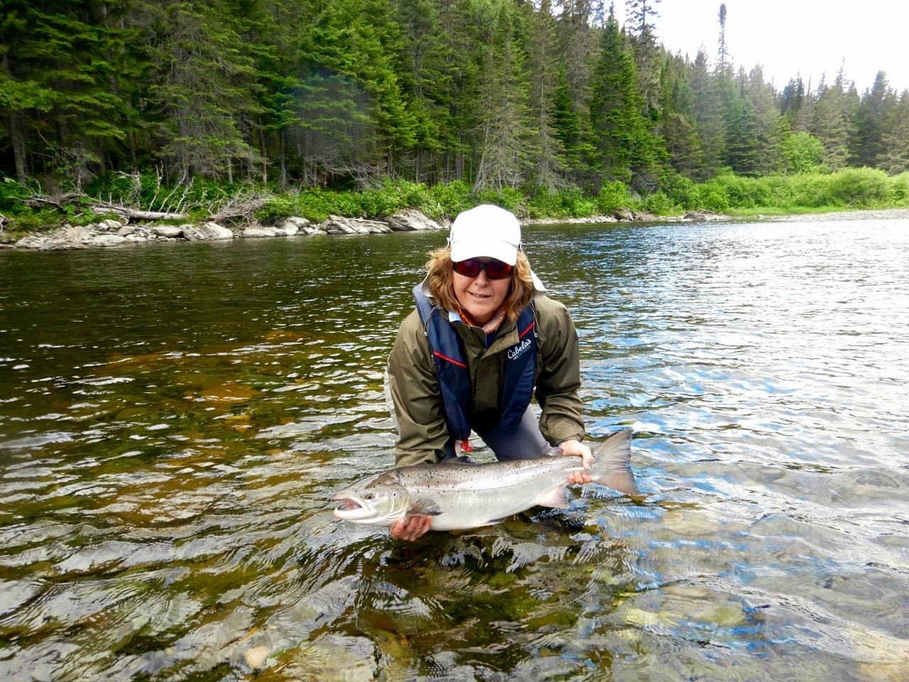 Nicole Armstrong has become a good friend and accomplished angler . here she is with a find Cascapedia salmon, nicely done Nicole