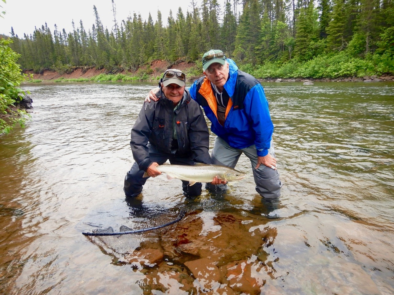 Bill McAlpin (right) and Salmon Lodge master guide Clement Bernier with Bill's first one from the Grand! Cascapedia