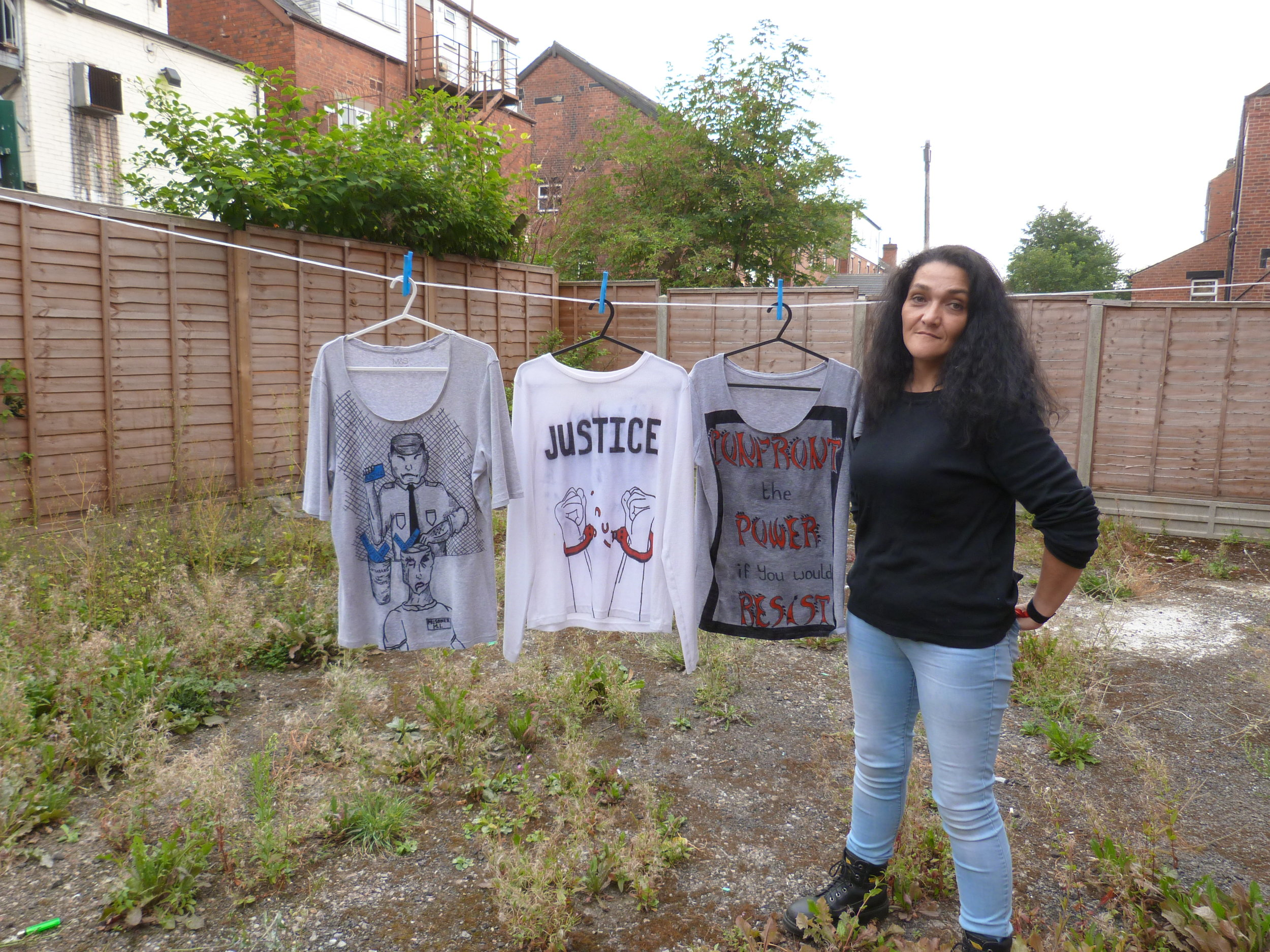 Cookie showing some of her original tees