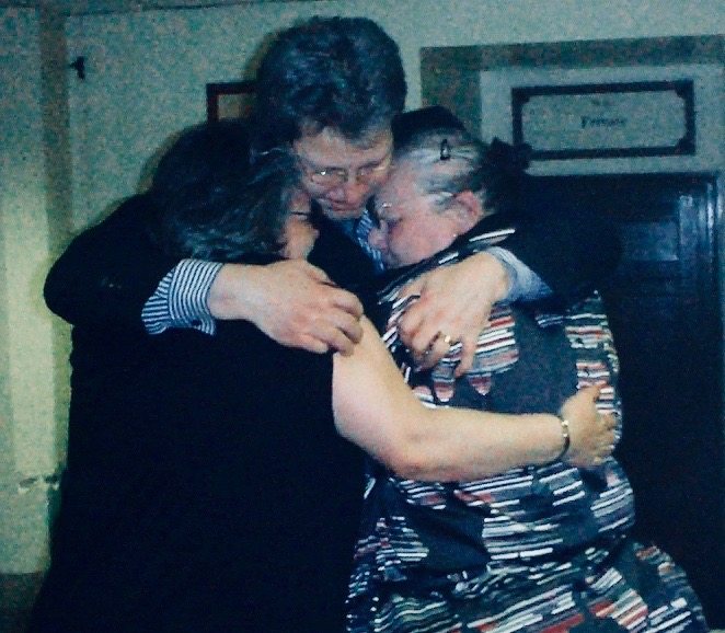 John Doe hugs his family after his conviction was quashed by the Court of Appeal
