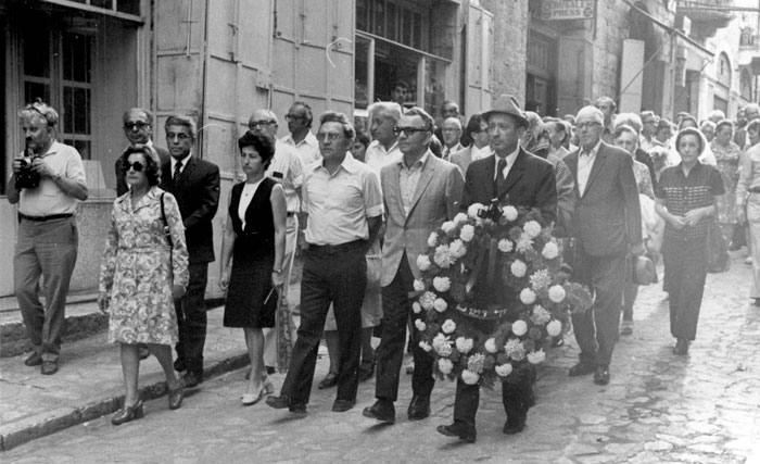 Jews saved by Schindler lead their savior's funeral procession.