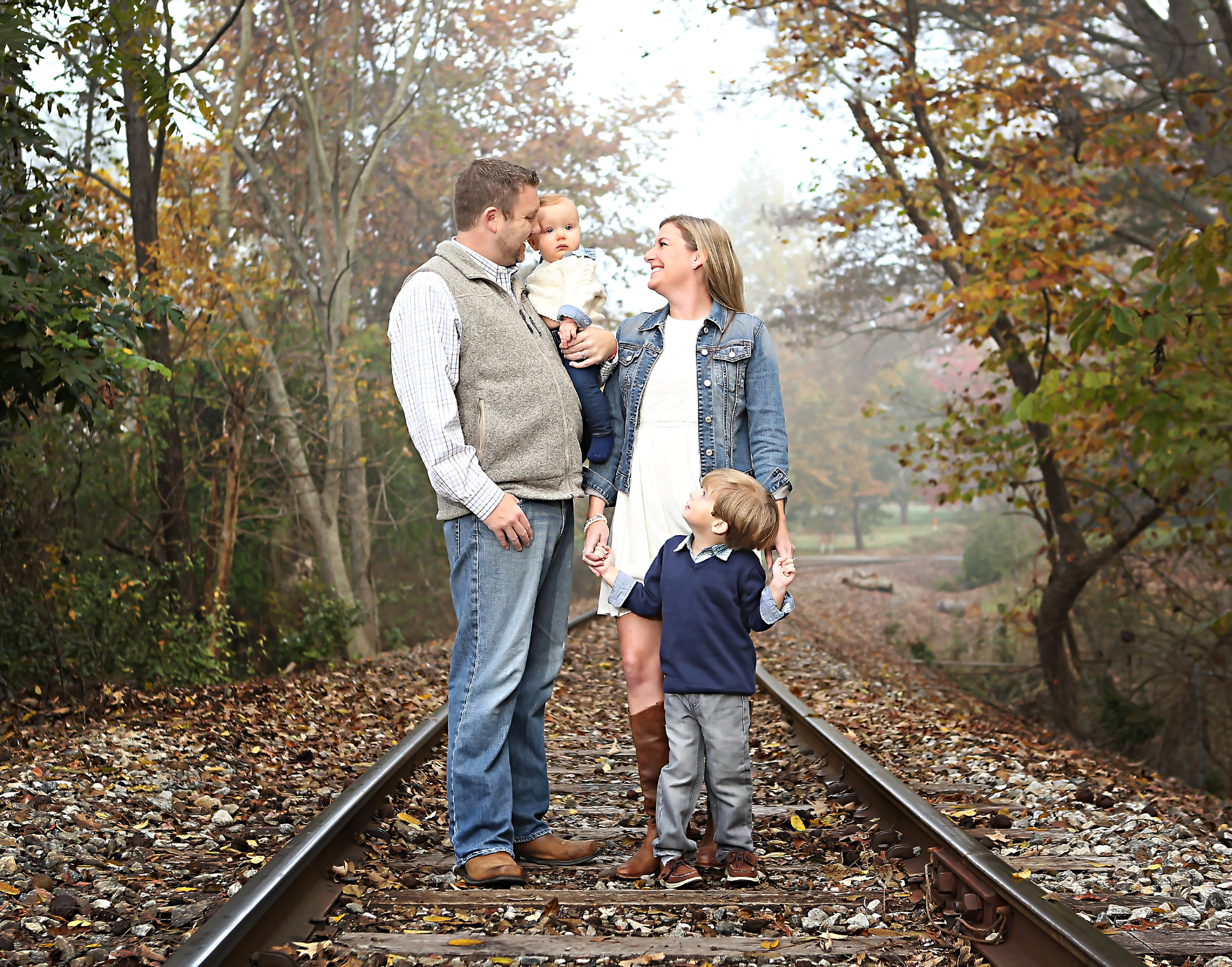 The fall season is an extremely popular time to have your family photographed, and we look forward to this season every year.  However, when the fabulous Pagel family came for their annual family portrait, something was different.  Their session was first thing in the morning.  The air was cool, and there was still some fog lingering from the rain the night before.  The result was a dreamy, almost painterly effect on the whole scene.