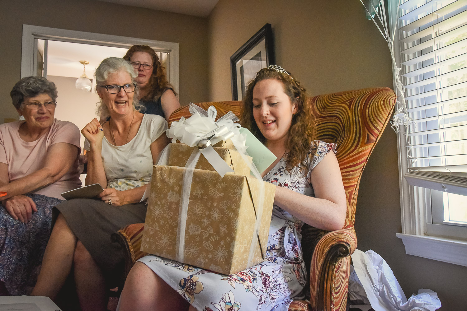 bride to be opening gifts with mom and grandma