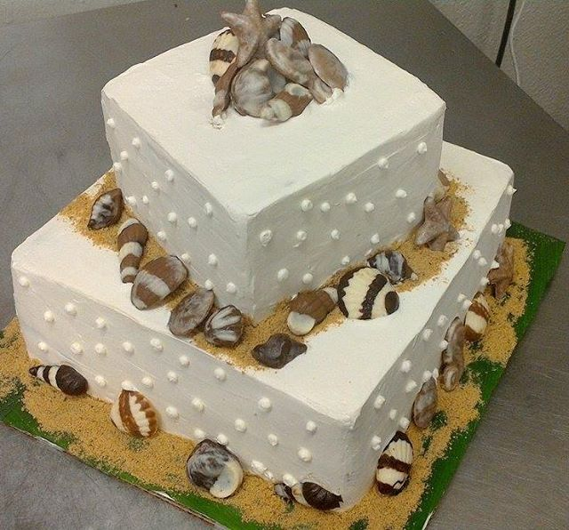 The Beach cake! #cakes #cakes #weddingcake #chocolateseashells #chocolate #ediblesand #localeats #viptreatandsweets