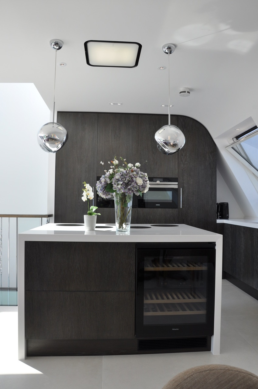 The hi-spec kitchen has a motorised sliding door concealing the washer/dryer and provides storage