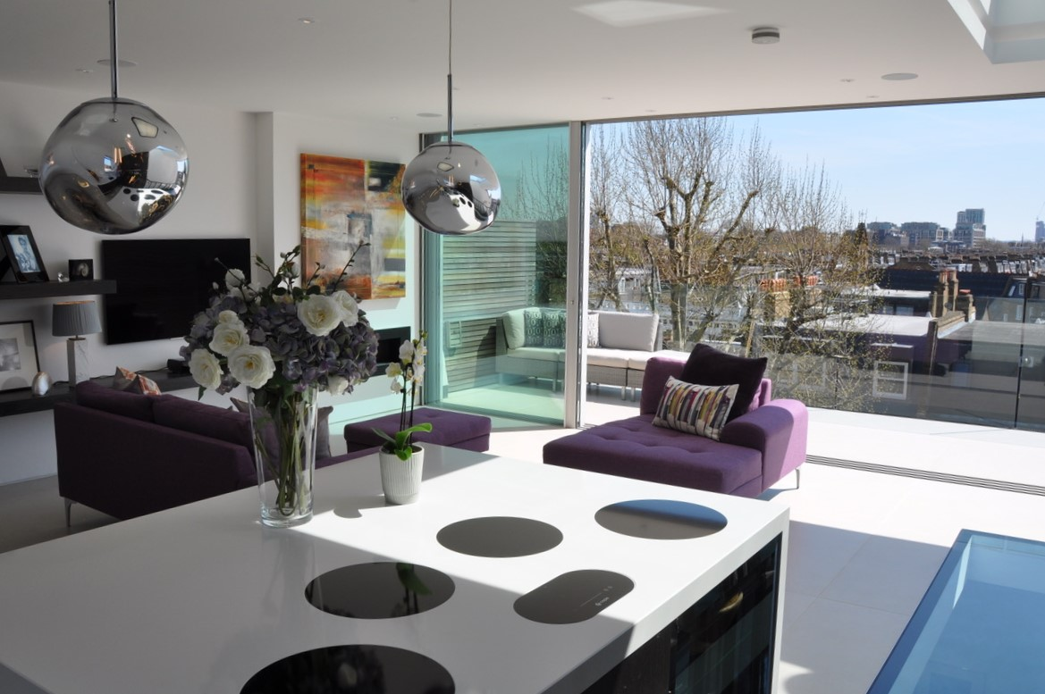 The open plan living area has superb natural light from large windows and doors