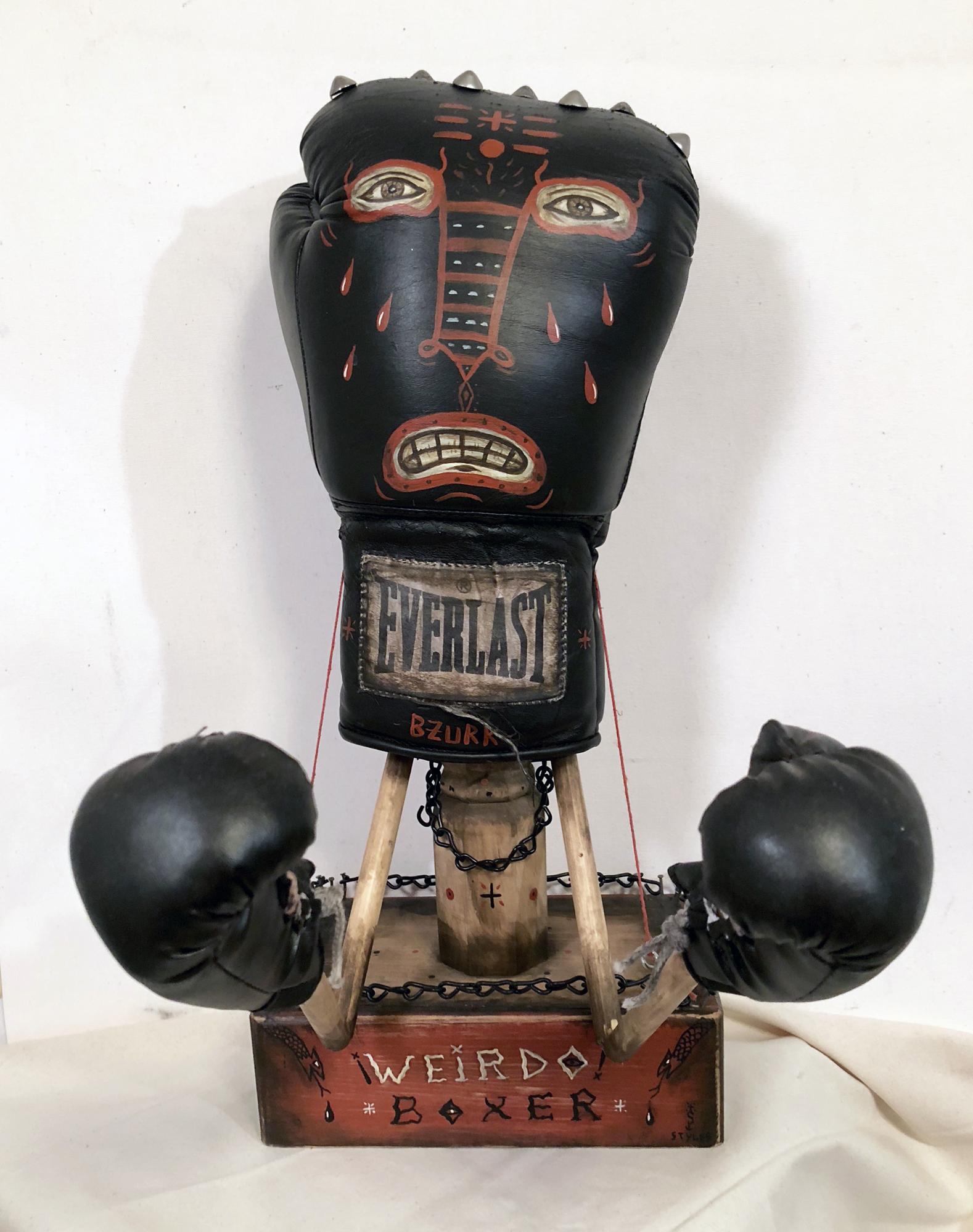 Weirdo Boxer,  Acrylic on boxing glove, marionette arms, 19 x 15 x 9, $850