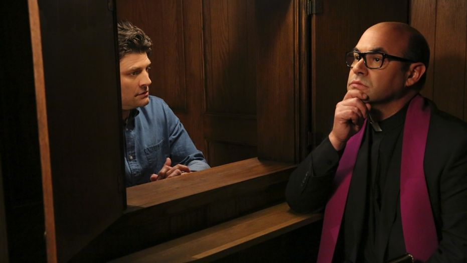 Chip seeks assistance on his spiritual journey from Father Gene, a Catholic priest (Ian Gomez). © CBS Studios