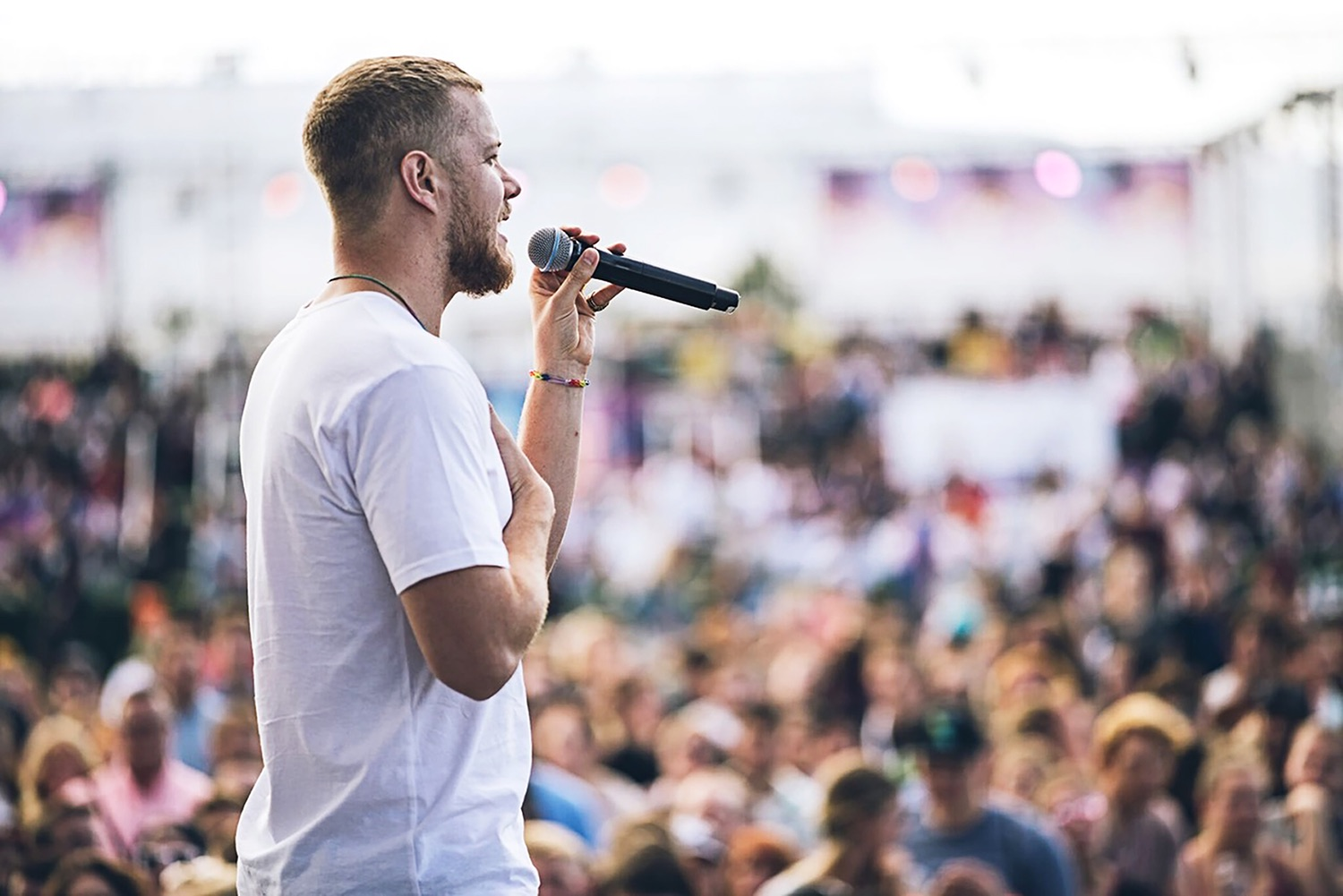 Dan Reynolds addresses the crowd gathered to attend the LoveLoud Festival in a scene from the new HBO documentary, Believer. /Photo courtesy of HBO.