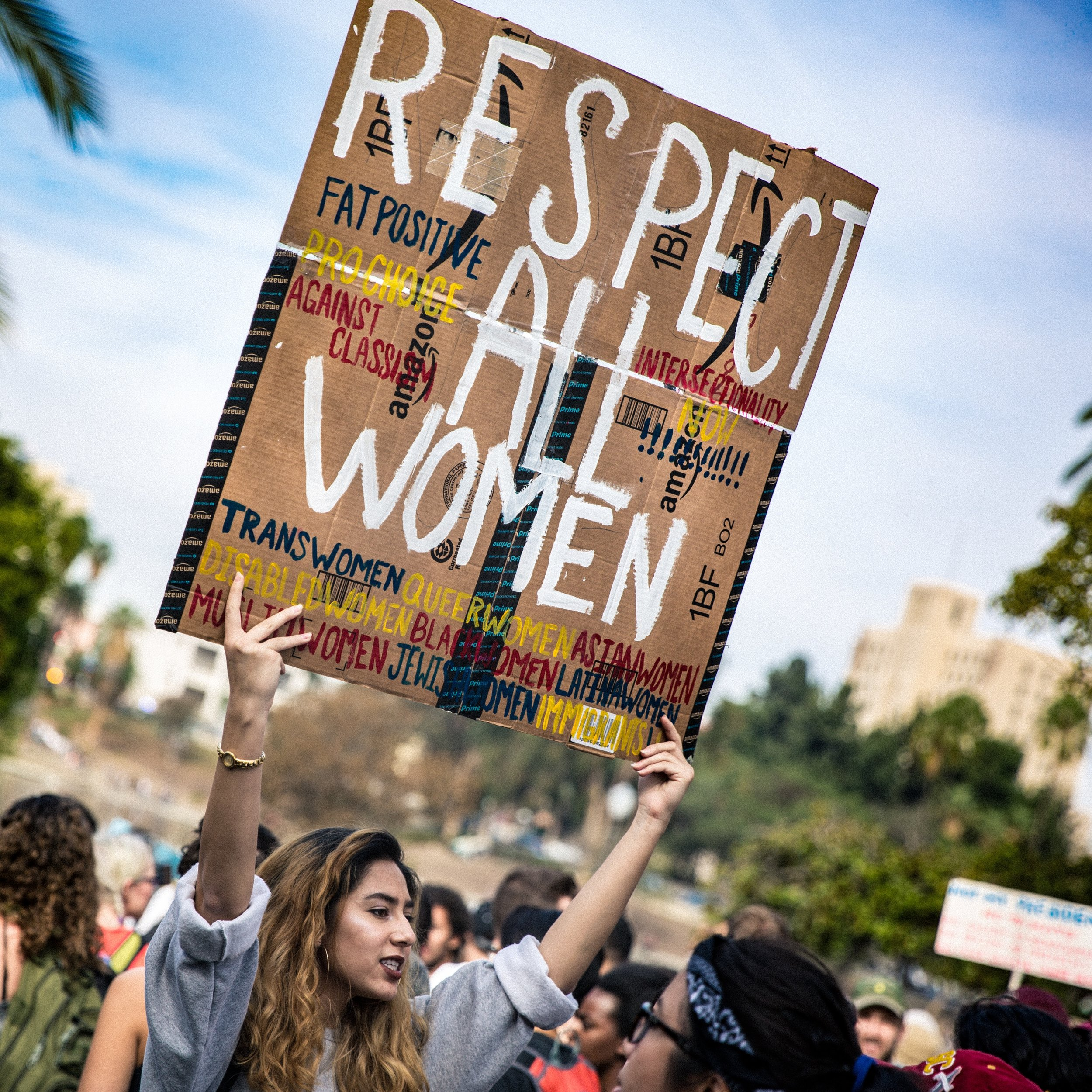 A protester holds up a sign demanding respect for all women during the post-election protest in Los Angeles, California in 2016. /  Photo by  T. Chick McClure  on  Unsplash .