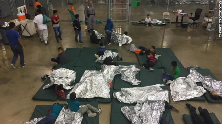 The interior of a CBP facility in McAllen, Texas. Yes. That's children. Sleeping on the floor. (CBP)