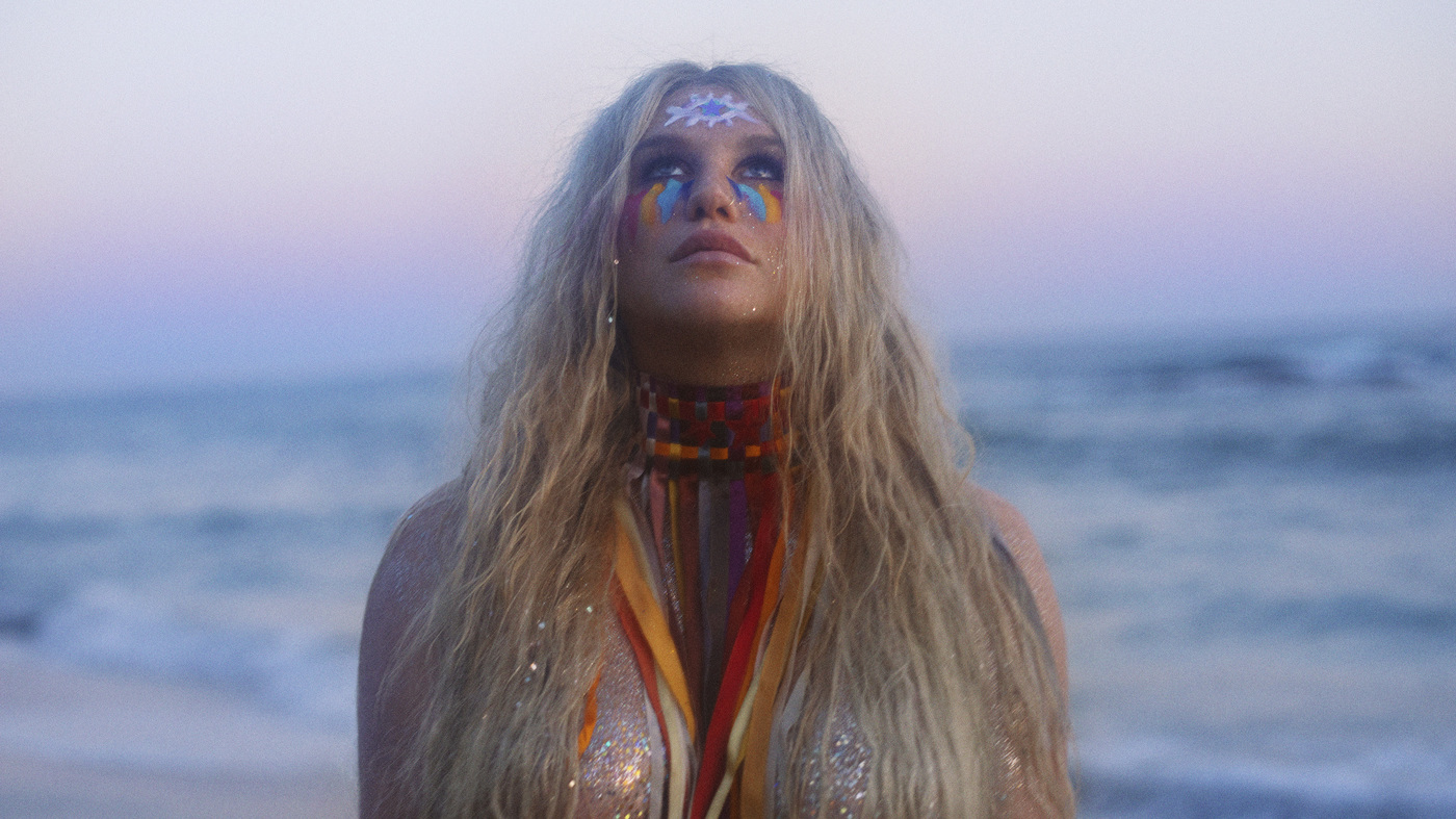 """Kesha's 2017 single, """"Praying,"""" delivers a message that is both utterly queer and profoundly Christian, writes William Stell."""