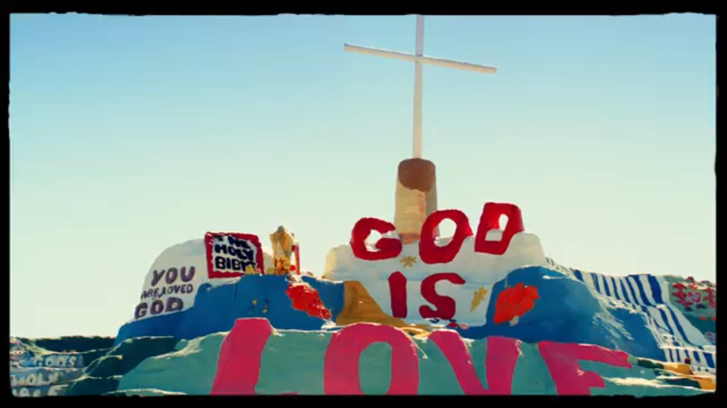 """The music video for """"Praying"""" features the California landmark """"Salvation Mountain."""" (Vevo)"""