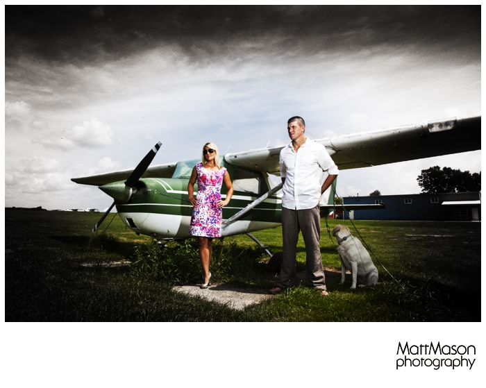 Vintage Engagement Portrait with airplane and yellow lab